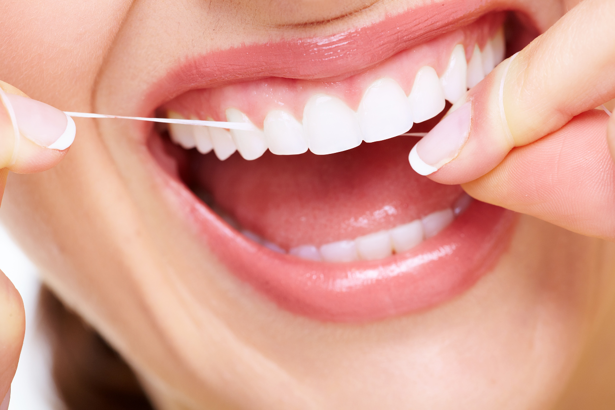 6 Things a Woman should do to her teeth for the beautiful smile!! flossing